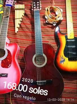 Guitarra acústica y clásica nuevos, violines, teclados, y instrumentos para niños.