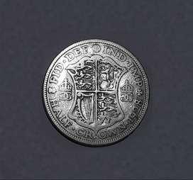 Media corona inglesa de 1928, plata 500, 32 mm, VG mas
