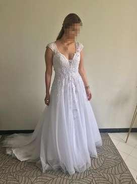 Vendo vestido de novia con velo nuevo