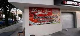 Cajera oficios varios en una seccion de carnes