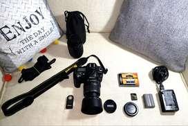 Cámara Nikon D90 con accesorios