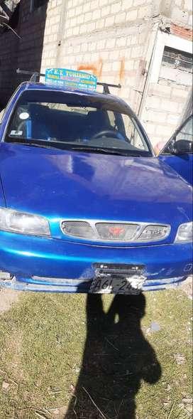 Vendo mi auto por motivos de viaje tal como esta en la foto a 11.500 precio negociable
