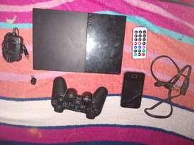PS2 com juego de poly stetion