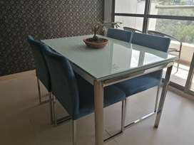 Comedor expandible con 4 sillas