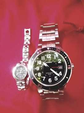 2 relojes originales dama y caballero x 290mil