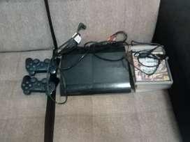 Ps3 con 2 mandos cargador y juegos