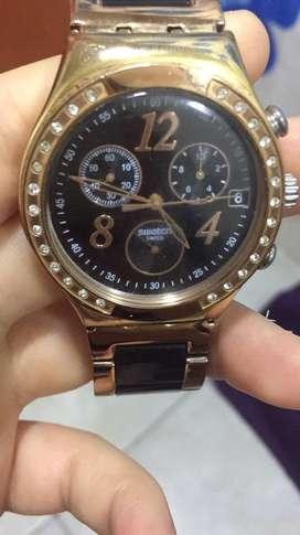Reloj swatch y anillo san benito