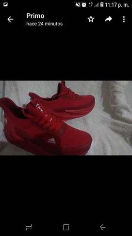 Vendo zapatos deportivos rojos marca addidas talla 42 nuevos