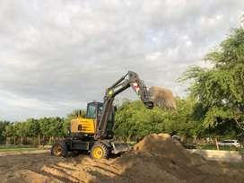 Alquiler de excavadora Volvo EW60C sobre ruedas 99 soles inc. Igv la hora