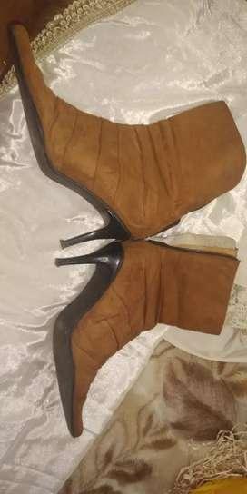 Botas chaqueta y bolso