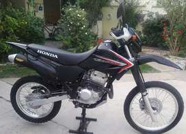Honda tornado impecable