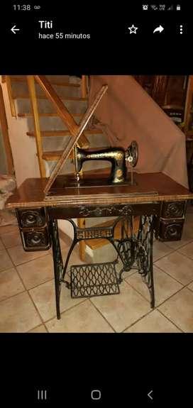 Máquina de coser antigua singer con pie de hierro SI FUNCIONA