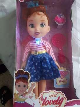 muñeca NUEVA CANTA Y HABLA