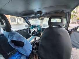 Suzuki Color negro, llantas radiales, negociable, documentos al día.