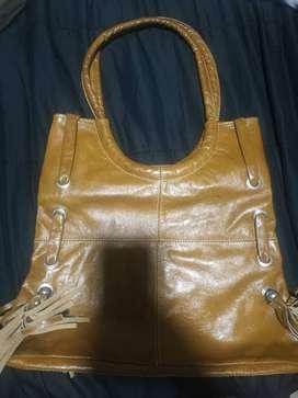 Cartera y bolso color mostaza nuevo