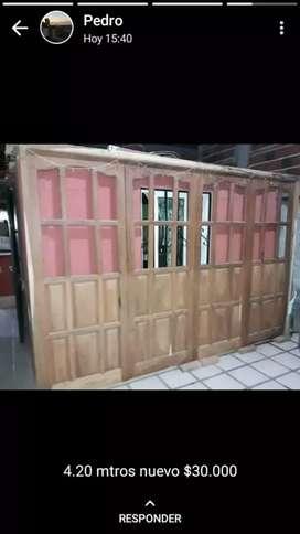 Vendo puerta de algarrobo para garage sin uso 4,20 de ancho