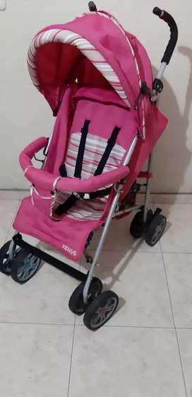 Coche paseador para bebe rosado