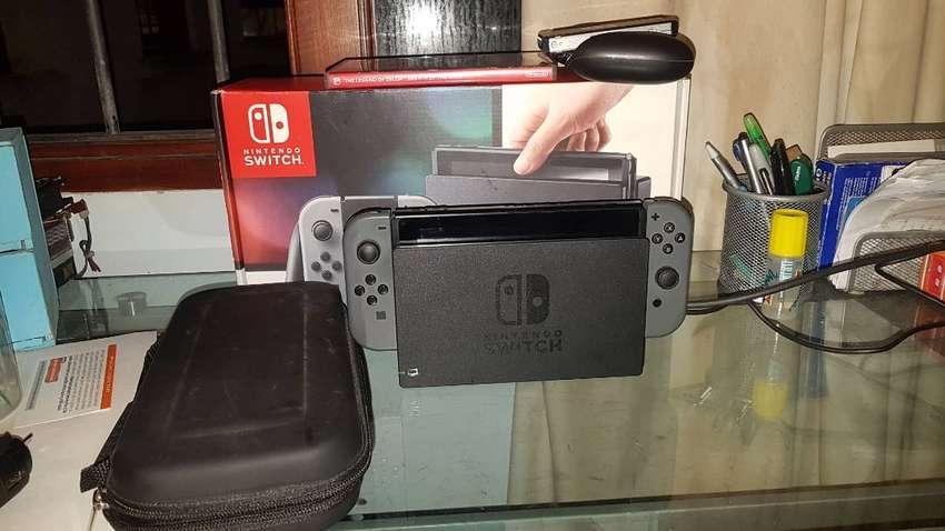 Nintendo Switch completa con Zelda breath of the wild y estuche 50