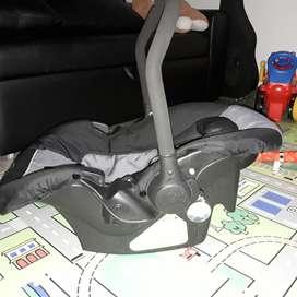 Cargador Silla de Carro Bebe Bebesit como nuevo permuto por tecnología o cosas de bici