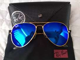 Vendo lindas Ray ban marco dorado y lente azul, filtro uv 400