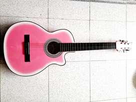 Guitarra rosada nueva