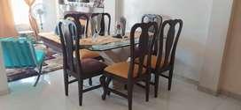 Vendo comedor 6 puestos, vidrio grueso y fino, base de marmol, asientos de madera