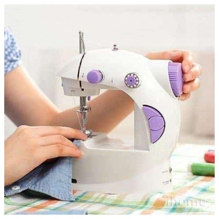 Mini maquina de coser de 2 velocidades