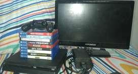 Consola Ps4 slim + 9 juegos físicos + 3 juegos digitales + Control con cable de carga + Obsequio.