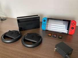 Consola Nintendo Switch + Base (HDMI) + Juego de Volantes Joy-Con + 3 Juegos