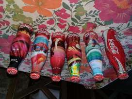 Coleccion de botellas de coca cola