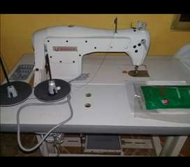 Maquina de coser nueva singer