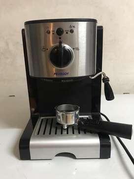 Cafetera con vaporizador para leche