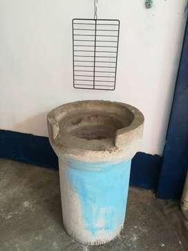 Asadero de carnes con tubo de concreto