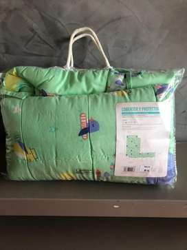 Cobertor y protector de cuna