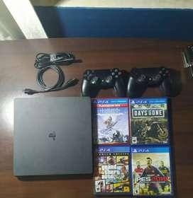 PS4 Slim 1 TB + 2 mandos + juegos.