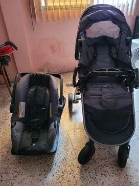 Evenflo coche con porta bebe y base para car seat
