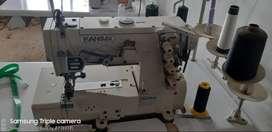 Maquina recubridora y colleretera marca KANSAI WX-8803MG  año 2017