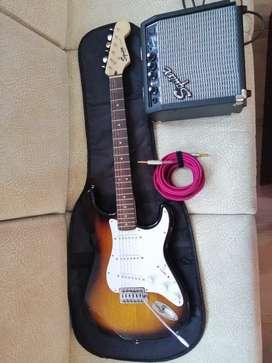 Guitarra con su estuche y amplificador