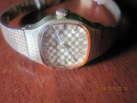 vendo cambio clasico reloj para dama ., INVICTA ., SUIZO DE CUERDA .,