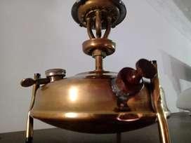 Estufa en bronce así como se ve en fotografía interesados chat