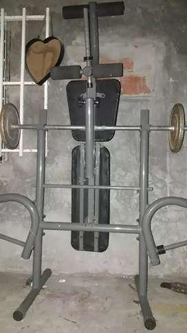 banco de gym .. con barra y discos