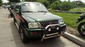 Vendo Carro Mitsubishi doble cabina 2004
