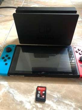 Nintendo switch en excelente estado, poco uso con un videojuego (  wwe )