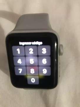 Vendo reloj apple  funcionando con su cargador.