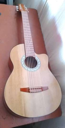 enseño a tocar guitarra
