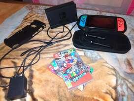Consola de nintendo con juegos y accesorios