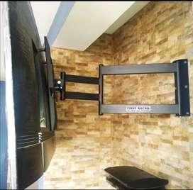 Bases de brazo instaladas para televisores hasta de 65 pulgadas