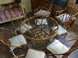 juego de comedor y dos sillones con almohadones