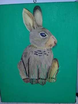 Cuadro de conejo en zona verde