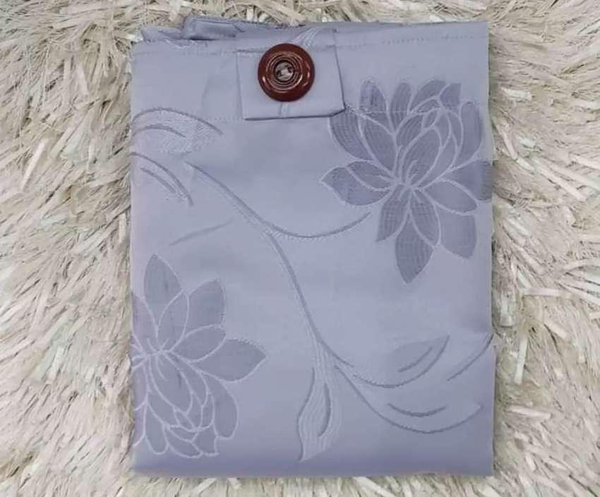 Se vende cortina nueva de 2 piezas de excelente calidad 0